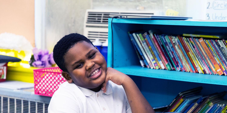 Smiling student at desk.